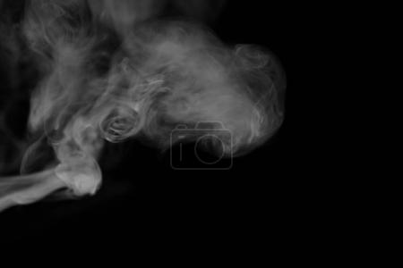 Photo for White smoke on a black background. Texture of smoke. Clubs of white smoke on a dark background for overlay - Royalty Free Image