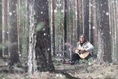 Guitarist in the woods at a picnic. A musician with an acoustic