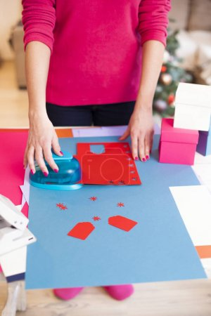 woman make scrapbook of the papers on the table