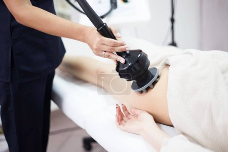 woman in beauty salon on cellulite treatment therapy