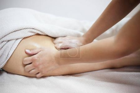 Anti cellulite massage for woman in beauty salon