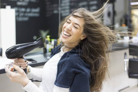 woman in hair salon doing her hair style
