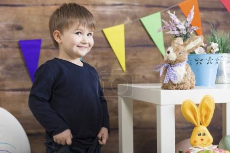Happy Easter! Happy baby boy playing on Easter day. Easter decor