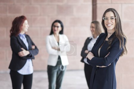 Successful smiling business woman leading a business group