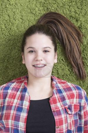Portrait of Young teen girl with braces on her teeth