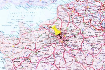 Yellow push pin pointing at Paris