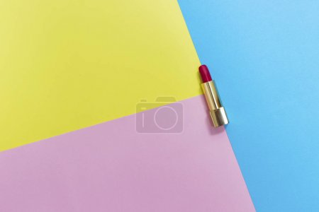 Photo for Top view of makeup set: red lipstick on pastel background. - Royalty Free Image
