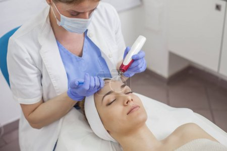 woman in the beauty salon on the face treatment