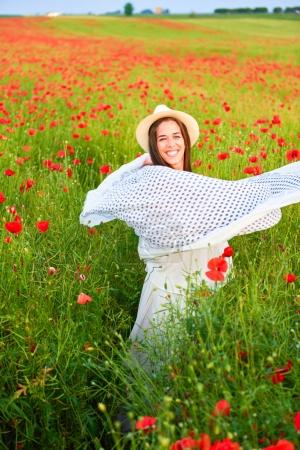 Woman in the field of red poppies