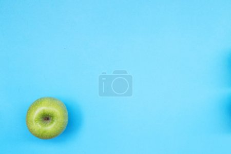 Top view of colorful fruit pattern of fresh apple on blue background