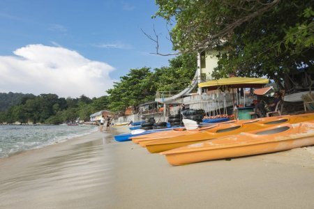 PANGKOR ISLAND, MALAYSIA - 17 DECEMBER 2017 : kayaks and buoy display on sandy beach for rent by tourist