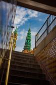 COPENHAGEN, DENMARK: View of the landmark green spire of the former St. Nicholas Church, now Nikolaj Contemporary Art Center in Copenhagen. Nikolaj Kunsthal