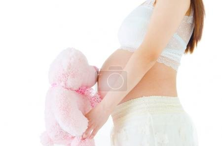 Photo for Pregnant woman holding a toy - Royalty Free Image