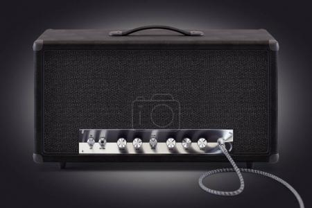 Photo for 3d render of analog guitar amplifier with inserted audio cable and shining chrome round knobs. - Royalty Free Image