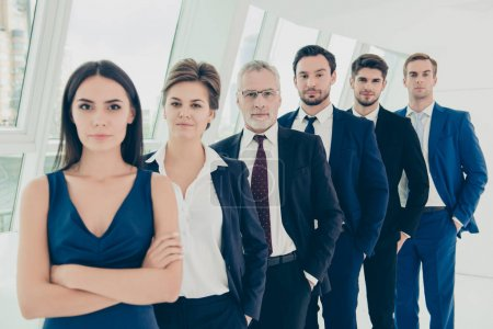 Team of successful and confident business people in modern offic