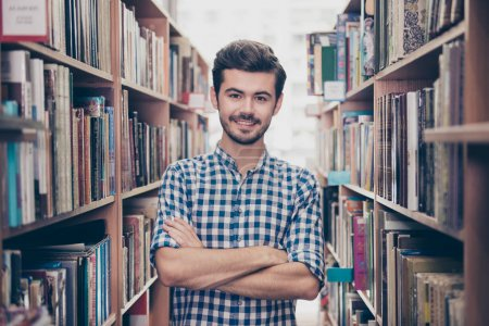 Cheerful clever young attractive brunet bearded student bookworm