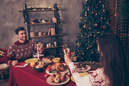 Festive friends with stemware are excited in knitted traditional
