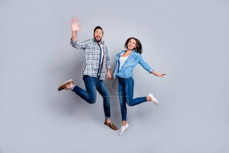 He and She full length portrait of attractive, playful, cheerful