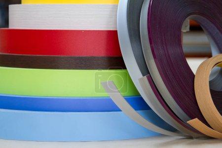 Multicolored bobbins of PVC edge