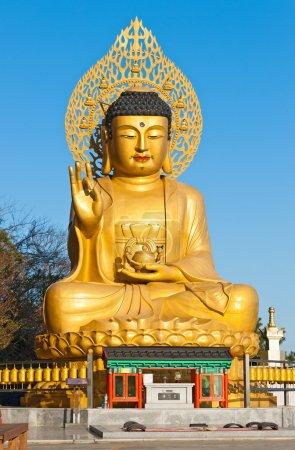 Golden Buddha statue at buddhist temple