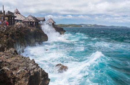 View of big waves at Crystal Cove small island near Boracay isla