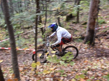 man biker riding in the forest