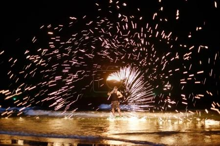 unidentified Firestarter performing amazing fire show at Koh Sam