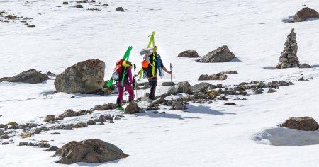 Free-riders ski climbers at the mountain summit in scenic Tian S