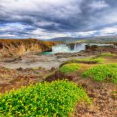 Incredible landscape scene of powerful Godafoss waterfall.