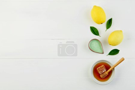 Homemade lemon salt bath and fresh honey in the plate with honey