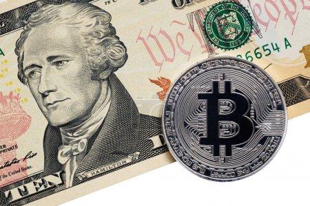 silver metal bitcoin and ten dollar bill