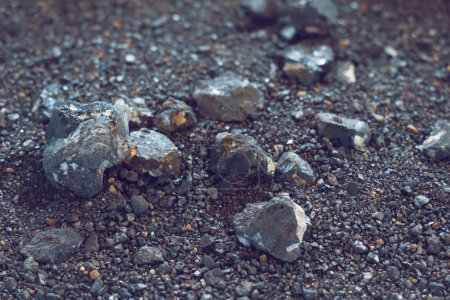 Small naturally tin ore sifting from streams, proc...