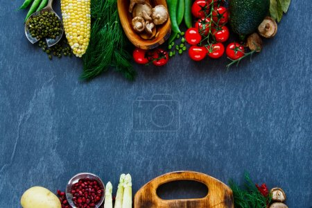Photo for Food frame. Delicious raw vegetables, mushrooms, herbs and grains on stone kitchen table, top view, copy space. Clean, healthy eating, vegan, detox, dieting food concept - Royalty Free Image