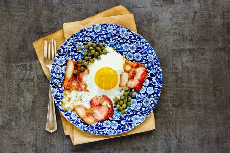 Photo for English breakfast with fried egg and bacon on vintage background flat lay - Royalty Free Image