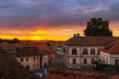 Awesome scenery of sunset over the ancient european city Sibiu in Romania.
