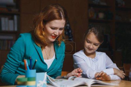 mother embracing daughter depressed about math homework