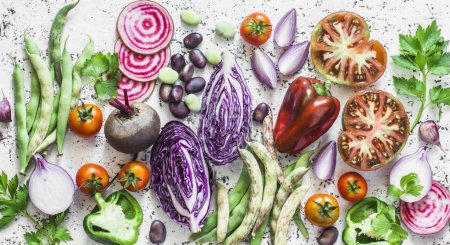 Photo for Fresh vegetables background. Cabbage, beets, green beans, tomatoes, peppers on a light background, top view. Flat lay. Vegetarian, diet food concept - Royalty Free Image