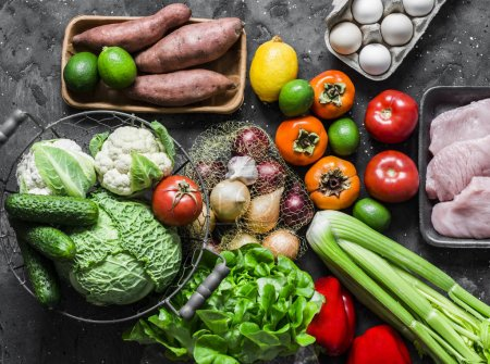 Photo for Eco products. Home menu planning concept - fresh fruits, vegetables, eggs, turkey meat on a dark background, top view. Healthy diet food - Royalty Free Image