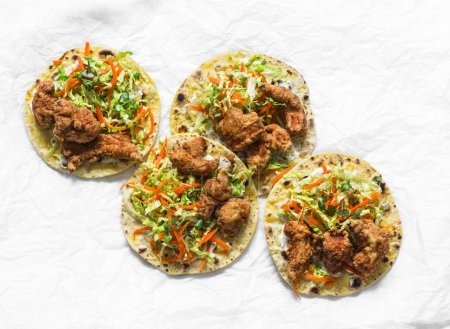 Photo for Korean tempura fried shrimp and coleslaw tacos on light background, top view - Royalty Free Image
