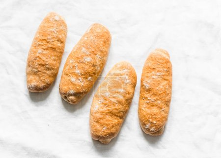 Photo for Homemade whole grain hot dogs buns on a light background, top view - Royalty Free Image