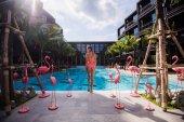 slim woman stretching yoga in swimming pool morning sea view