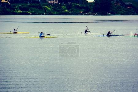Water sports image, people rowing in canoe on river