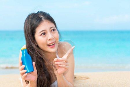 sexy woman wearing bikini clothing lying on beach