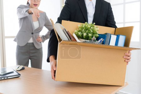 employee girl holding personal box ready to leave
