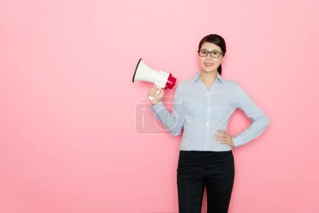 smiling pretty business woman holding loudspeaker
