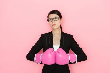 confident female lawyer wearing boxing gloves