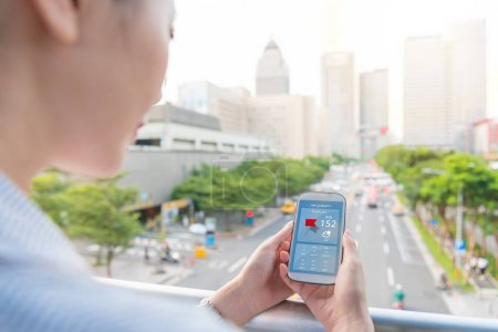 woman looking at air quality index app