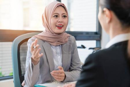 Businesswoman discussing.