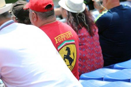 Man Wearing A Red Ferrari