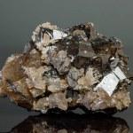 Macro mineral cassiterite stone on gray background...